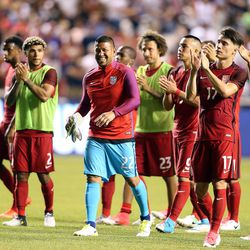 United States goalkeeper Nick Rimando (22) looks up at the crowd with his team after a soccer game against Venezuela at Rio Tinto Stadium in Sandy on Saturday, June 3, 2017. They tied 1-1.
