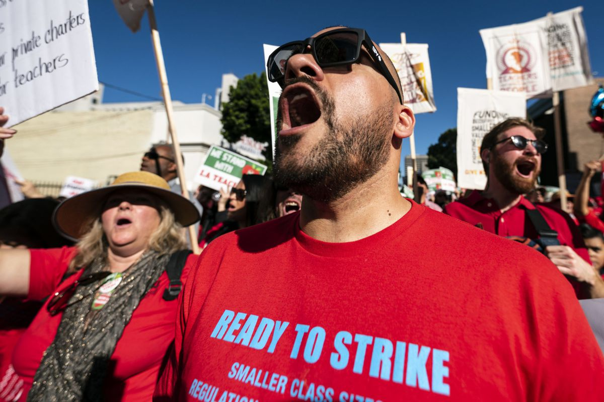 Teachers and supporters of public education march against education funding cuts during the March for Public Education in Los Angeles, California on December 15, 2018. The rally, organized by United Teachers Los Angeles, drew thousands of educators who demanded wage increases and smaller class sizes. (Photo by Ronen Tivony/NurPhoto via Getty Images)