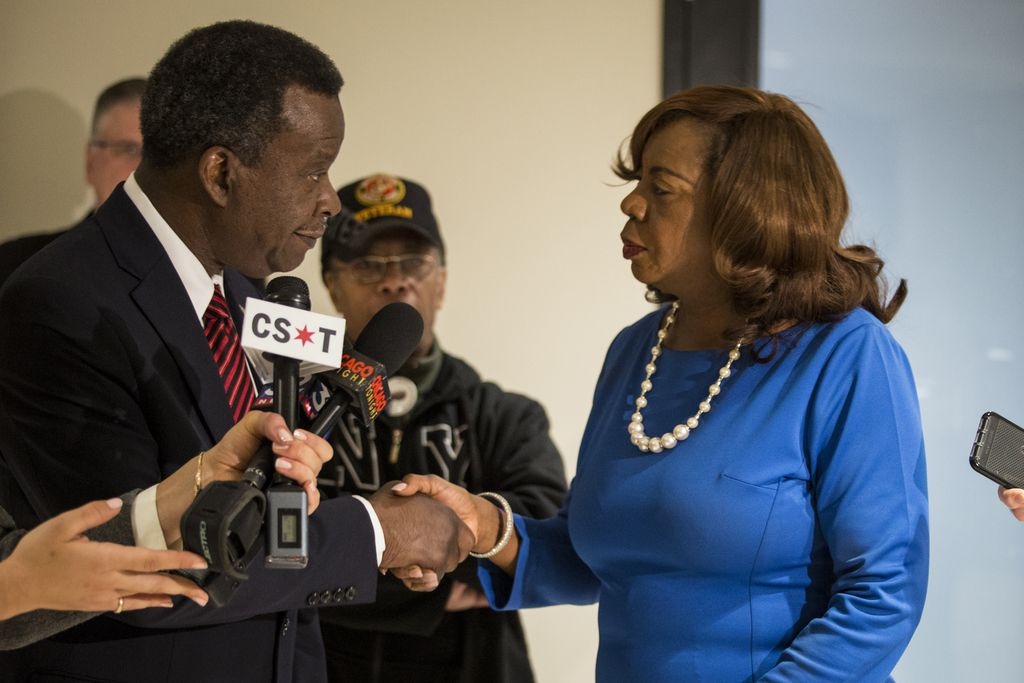 Chicago mayoral candidates Willie Wilson and Dorothy Brown shake hands as they speak to reporters outside the Board of Elections after Wilson withdrew his objection to Brown last week. File Photo. | Ashlee Rezin/Sun-Times
