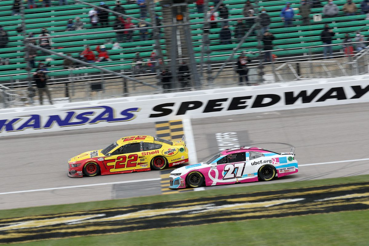 Joey Logano, driver of the #22 Shell Pennzoil Ford, crosses the finish line to win the NASCAR Cup Series Hollywood Casino 400 at Kansas Speedway on October 18, 2020 in Kansas City, Kansas.