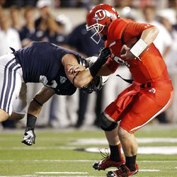 Utah Utes quarterback Jon Hays (9) is sacked by Brigham Young Cougars linebacker Spencer Hadley (2)   in Salt Lake City  Sunday, Sept. 16, 2012.