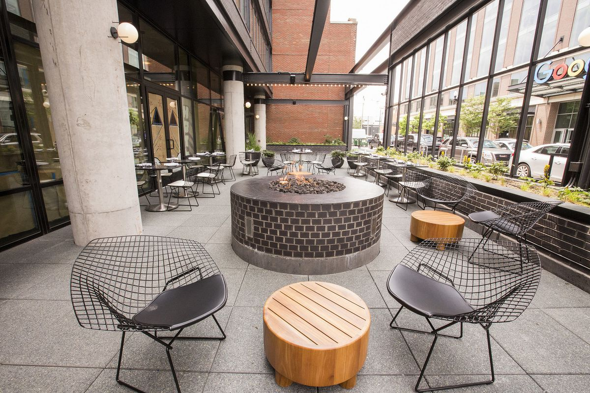 A fire pit sits on a patio.