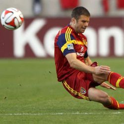 Real Salt Lake's Chris Wingert kicks the ball and keeps it from going out of bounds during a soccer game against the Portland Timbers at the Rio Tinto Stadium in Sandy on Saturday, April 19, 2014. Real Salt Lake won 1-0.