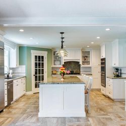 AFTER: This is a good example of how an outdated kitchen can be transformed with an updated style with a remodel.