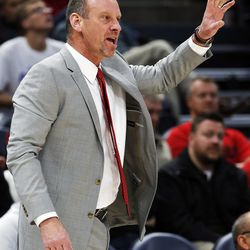 Utah Utes head coach Larry Krystkowiak instructs his team during NCAA basketball against the Utah State Aggies at Vivint Smart Home Arena in Salt Lake City on Saturday, Dec. 9, 2017.