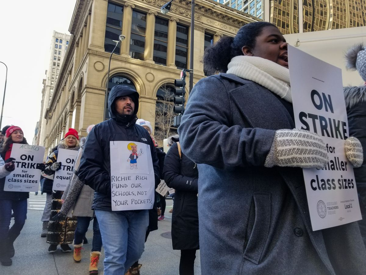 Teachers strike for the third day in front of the Illinois Network of Charter Schools headquarters. | Manny Ramos/ Sun-Times