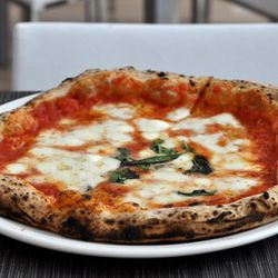 """Margherita Pizza from PizzArte by <a href=""""http://www.flickr.com/photos/slice/5968184001/in/pool-eater/"""">Adam Kuban</a>."""