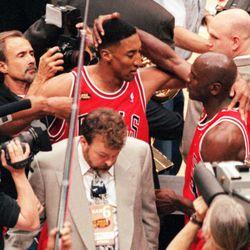 Michael Jordan, right, hugs teammate Scottie Pippen after winning the NBA title in 1998.
