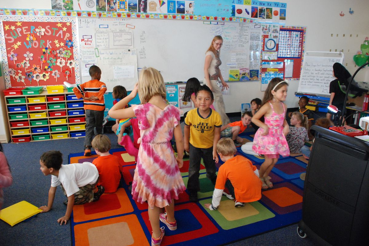 Students move about a classroom at the Denver Green School.