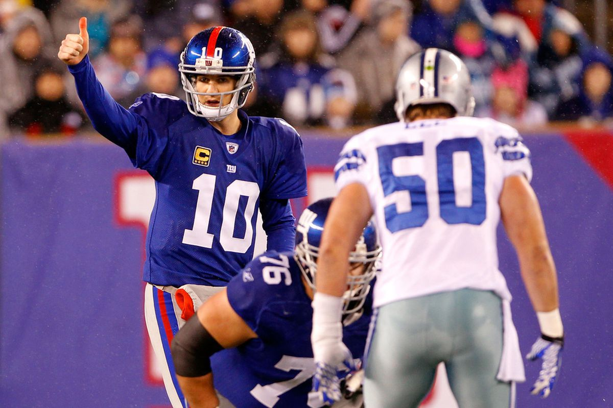 EAST RUTHERFORD, NJ - JANUARY 01:  Eli Manning #10 of the New York Giants gestures against the Dallas Cowboys at MetLife Stadium on January 1, 2012 in East Rutherford, New Jersey.  (Photo by Rich Schultz/Getty Images)