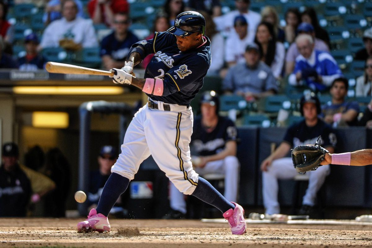 """Here's Nyjer Morgan with an infield hit in his pink cleats Sunday. He opted not to use the pink bat that came with """"Nyger"""" on it."""