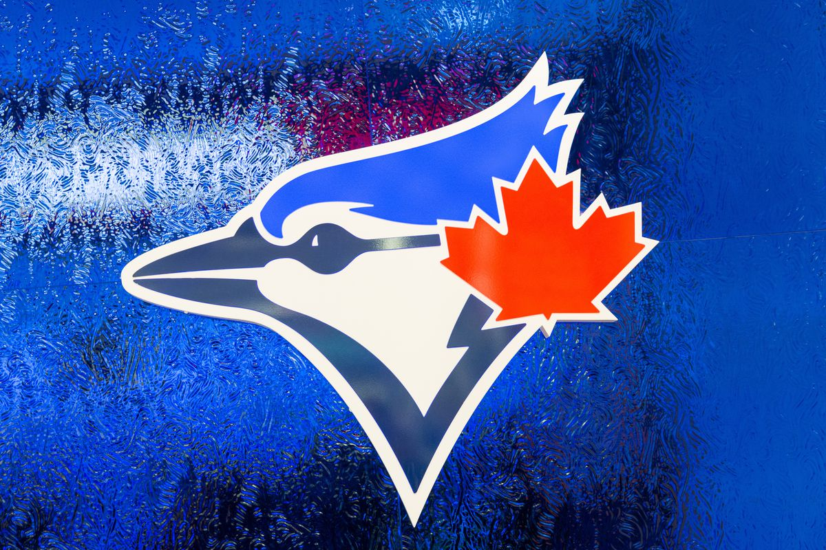 Logo of the Toronto Blue Jays baseball team on a blue frosted glass.