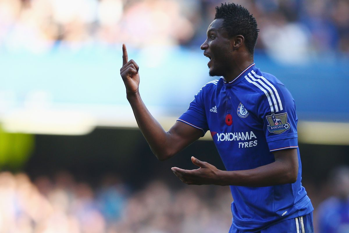 Mikel protests his yellow card after Emre Can got away with a billion fouls.