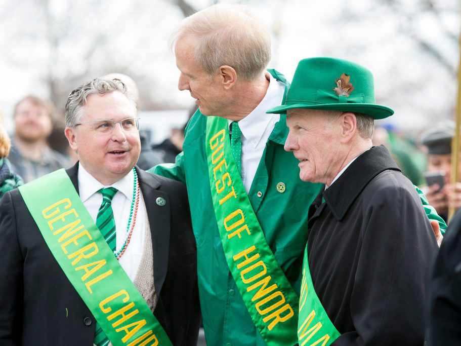 Gov. Bruce Rauner, center, talks to Illinois House Speaker Michael Madigan, right, and Parade Chairman Jim Coyne, left, at the Chicago St. Patrick's Day parade in 2016. File Photo. James Foster / For Sun-Times Media