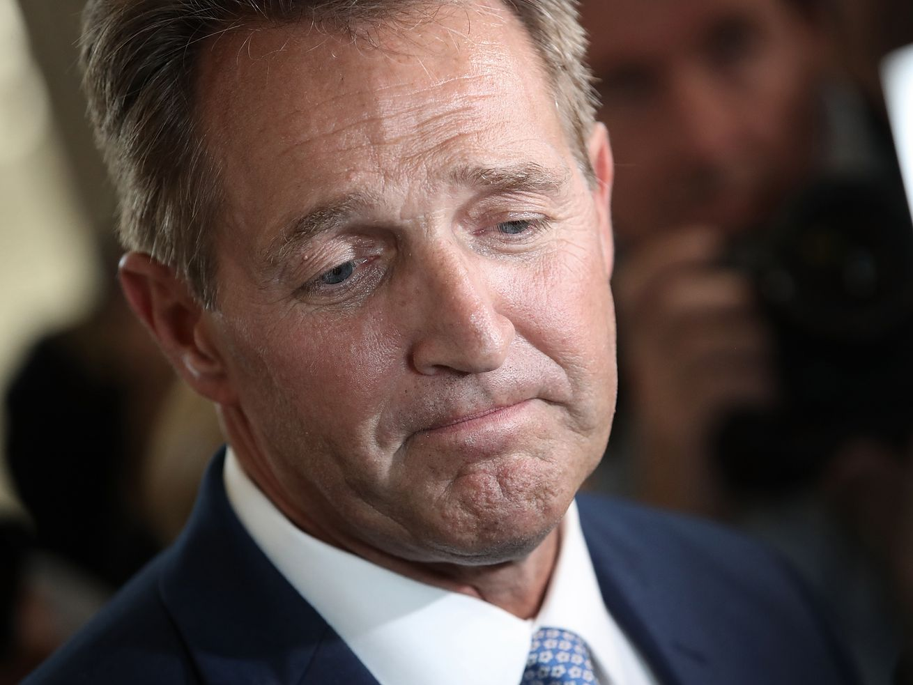 Jeff Flake after announcing he will not seek reelection on October 24, 2017.