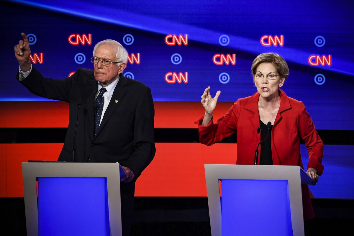 Democratic presidential hopefuls Sen.=Bernie Sanders (D-VT) and Sen. Elizabeth Warren (D-MA) speak during in the first round of the second Democratic primary debate on July 30, 2019.