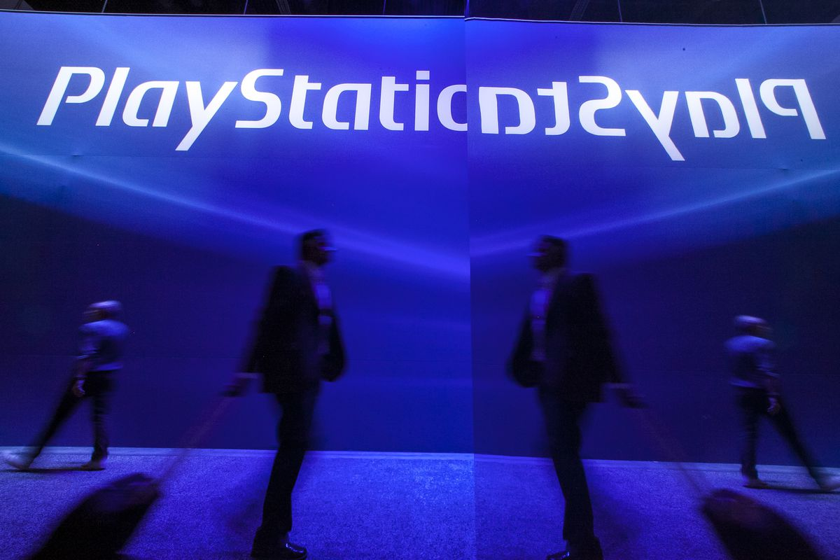 Show attendees walk past the Sony Playstation booth at E3 2012 in Los Angeles, Tuesday, June 5, 2012. The Electronic Entertainment Expo (E3), the premier convention for the computer and video game industry, is returning once again to Los Angeles for its annual gathering from June 5-7. (AP Photo/Damian Dovarganes)