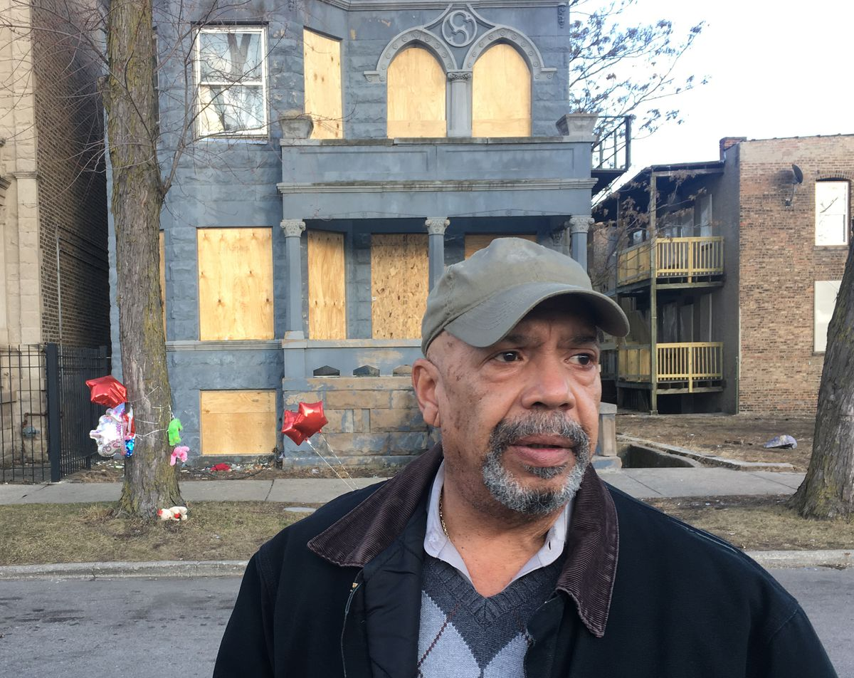 Retired cop Ed Adams said he tried to get into the house, but the smoke and flames were too much.   Mitch Dudek/Sun-Times