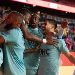 FOXBOROUGH, MA - APRIL 20: New England Revolution forward Cristian Penilla #70 is congratulated by his teammates after scoring the game's only goal against the New York Red Bulls at Gillette Stadium on April 20, 2019 in Foxborough, Massachusetts. (Photo by J. Alexander Dolan - The Bent Musket)