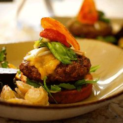 Chef Gray's Garden Burger: Pride of the Plains 28-day dry-aged beef, pickled ramps, local red Swiss chard, red onion marmalade and a house-made potato chip on an open-face brioche bun accompanied by a salad of early spring vegetables, such as courgettes,