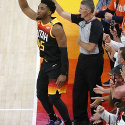 Utah Jazz guard Donovan Mitchell (45) hits a 3-pointer during the NBA playoffs in Salt Lake City on Thursday, June 10, 2021. The Jazz won 117-111.