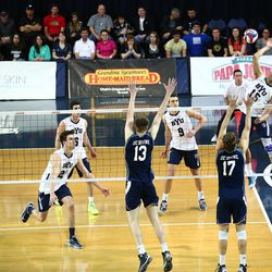 BYU's Taylor Sander (#15) spikes the ball past UC Irvine.  #3 BYU defeated #8 UC Irvine 3-0 at the Smith Fieldhouse on the Campus of Brigham Young University in Provo, Ut.March 14, 2014Photo by Jaren Wilkey/BYUCopyright BYU Photo 2014All Rights Reservedphoto@byu.edu  photo.byu.edu