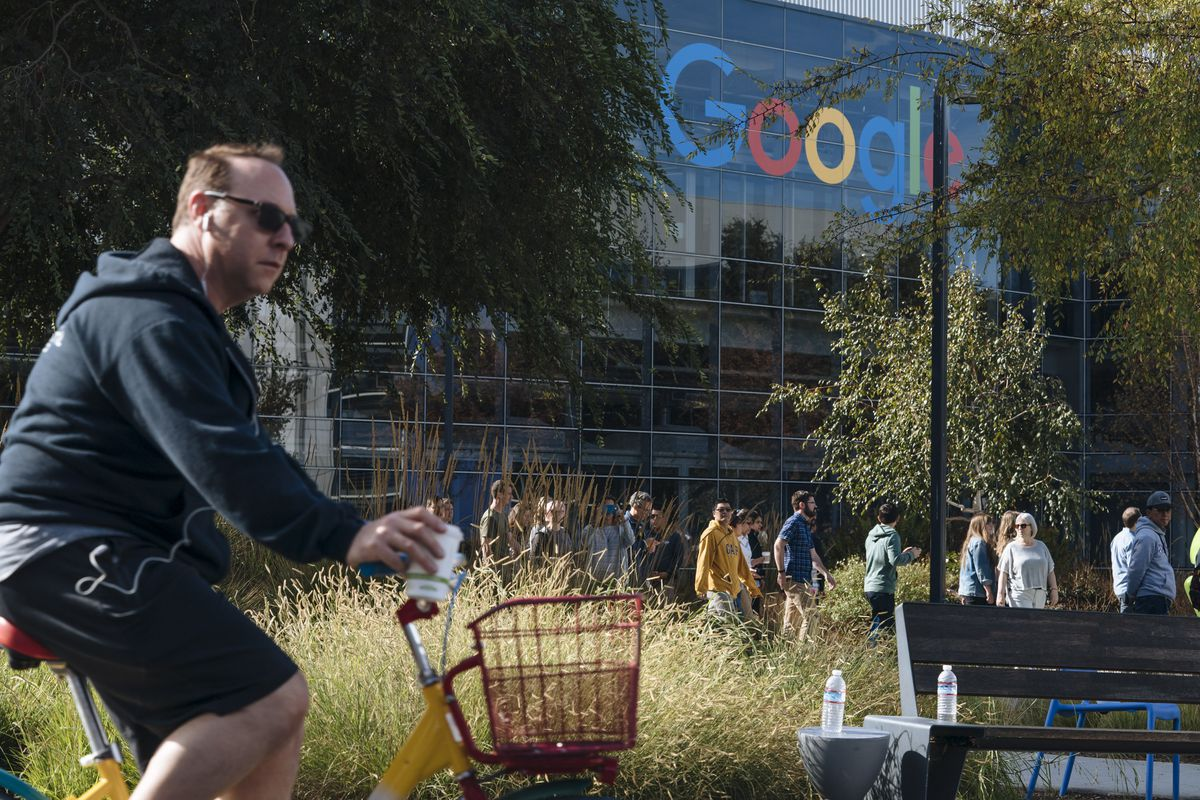 A man on a bike outside Google headquarters in Mountain View