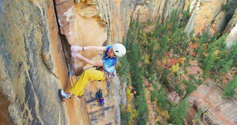 Lor Sabourin climbs a rockface.