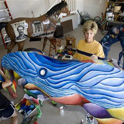 Local artis Wendy Dimick paints fiberglass horses for Ogden Pioneer Days. She and and two of her students completed the last three of their horses this week.