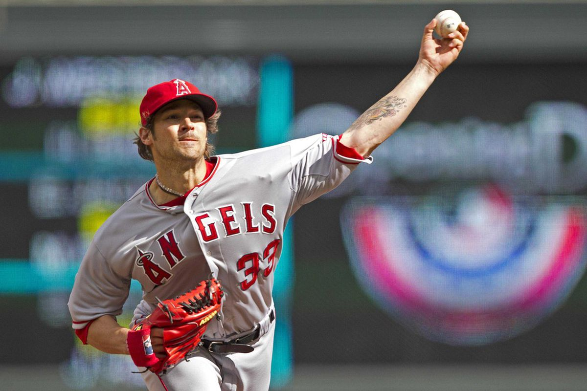 Los Angeles Angels starting pitcher C.J. Wilson (33) delivers a pitch in the first inning against the Minnesota Twins at Target Field.