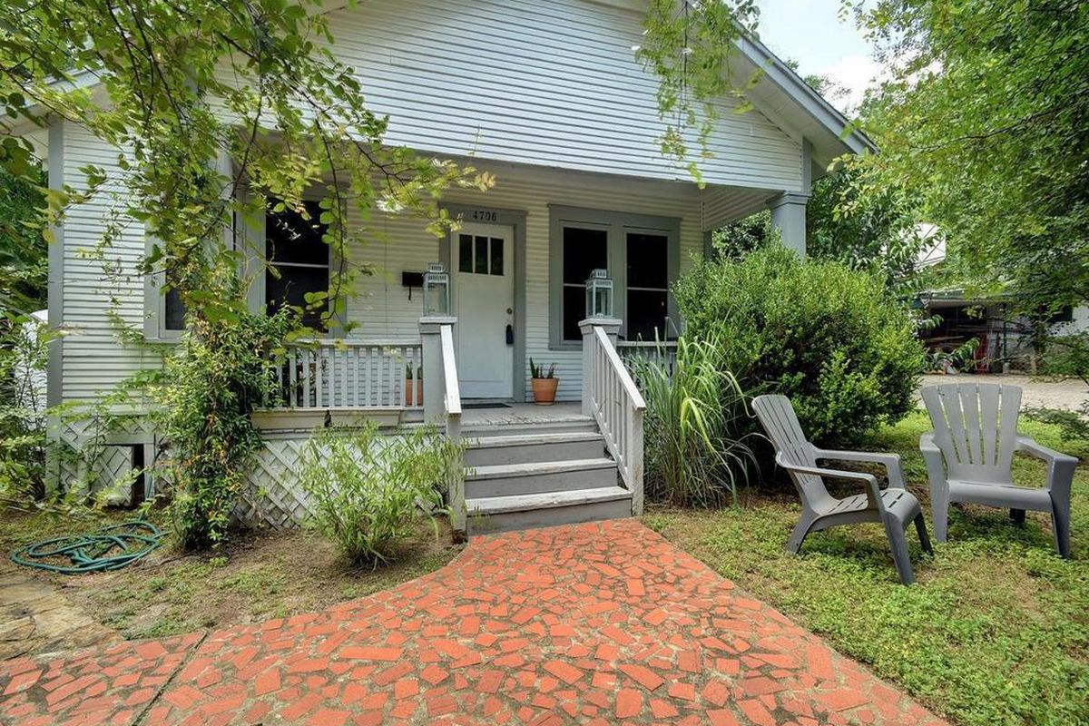 1938 wood frame home with front porch and steps