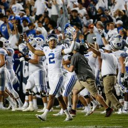 BYU players celebrate after winning against Arizona State during an NCAA college football game at LaVell Edwards Stadium in Provo on Saturday, Sept. 18, 2021.