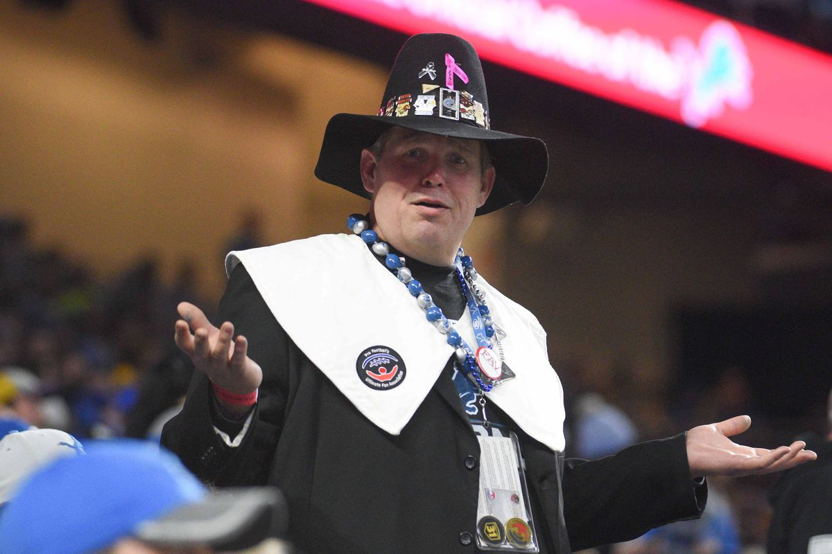 A fan dressed up as a pilgrim during the Thanksgiving game between the Detroit Lions and the Minnesota Vikings at Ford Field.