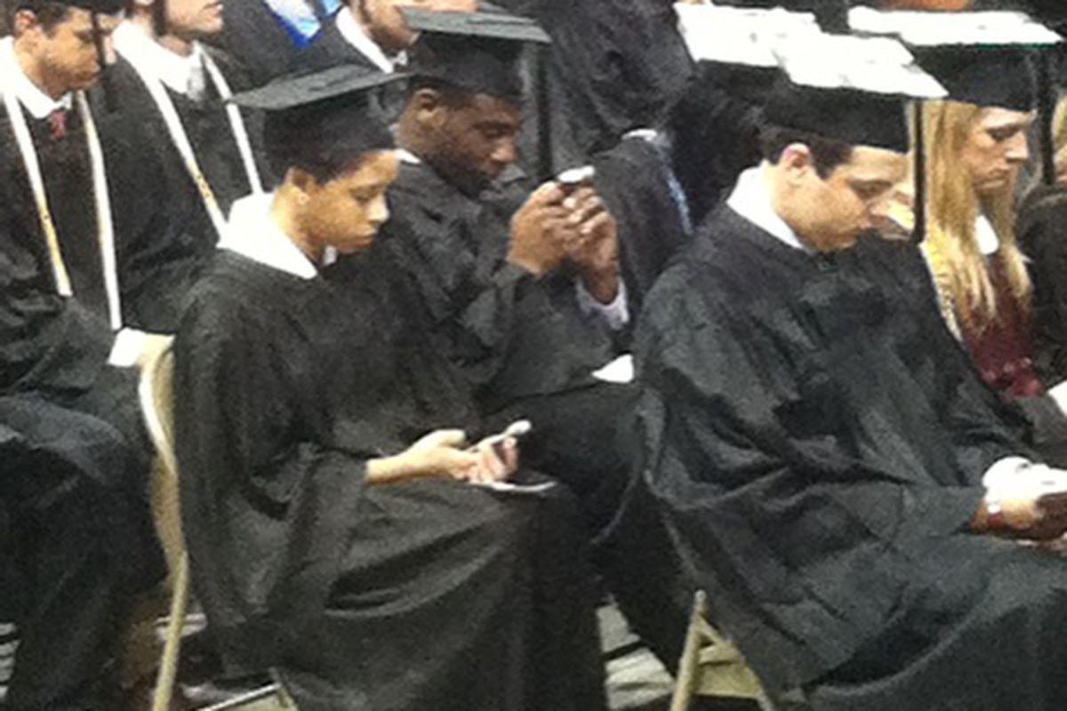 "Vick Ballard graduating... and texting (via TMZ Bob's <a href=""https://twitter.com/#!/bobcarskadon/status/201333712816836610"" target=""new"">Twitter</a>)"