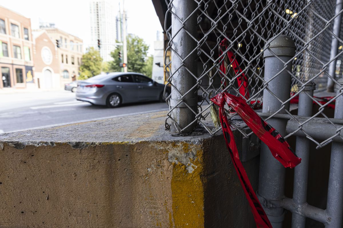 Crime scene tape wrapped on some fence near N Milwaukee and W Hubbard in the Fulton River District Thursday, Sept. 30, 2021.