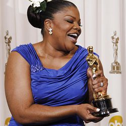 Mo'Nique exults backstage with the Oscar for best performance by an actress in a supporting role.