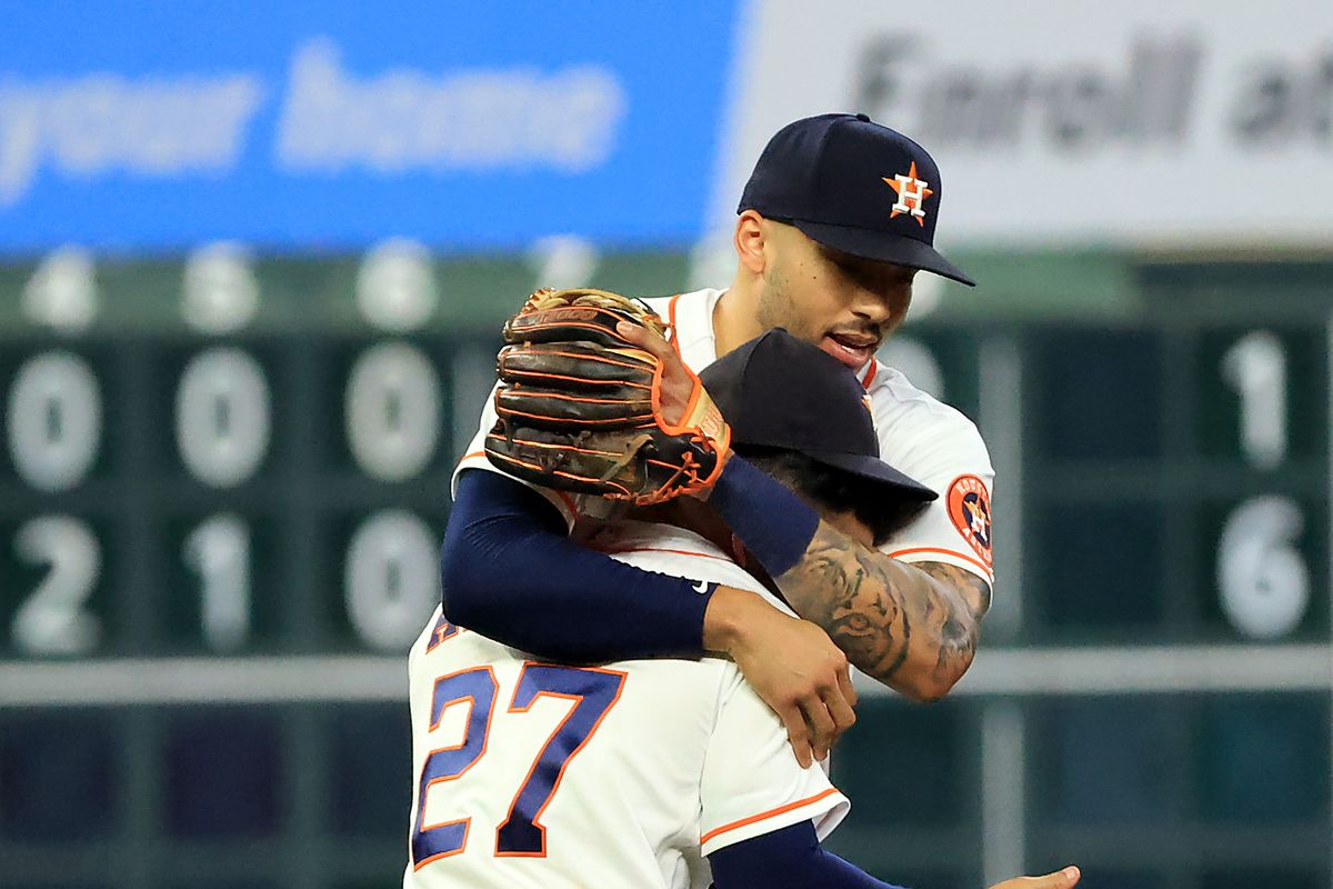 Carlos Correa #1 and Jose Altuve #27 of the Houston Astros congratulate each other after the Astros defeated the Chicago White Sox 6-1 to win game 1 of the American League Division Series against the Chicago White Sox at Minute Maid Park on October 07, 2021 in Houston, Texas.