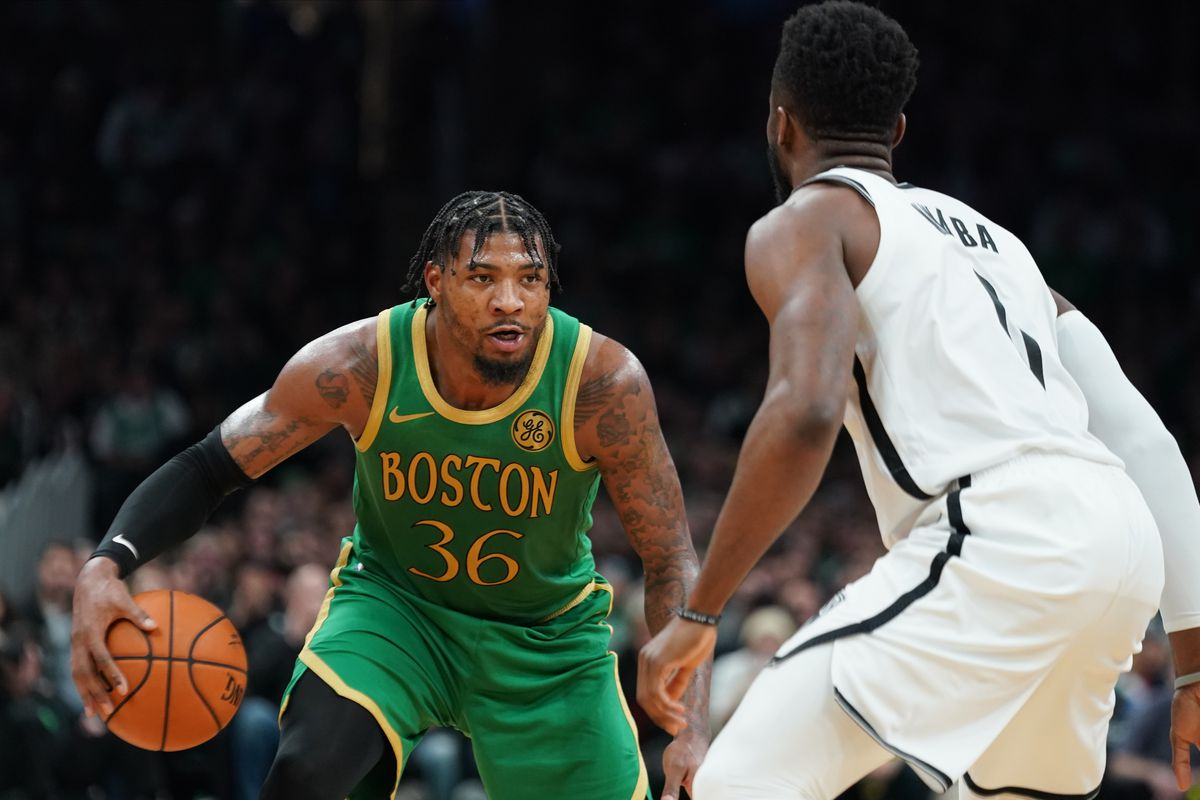 Boston Celtics guard Marcus Smart works the ball against Brooklyn Nets guard David Nwaba in the second half at TD Garden. Celtics defeated the Nets 121-110.