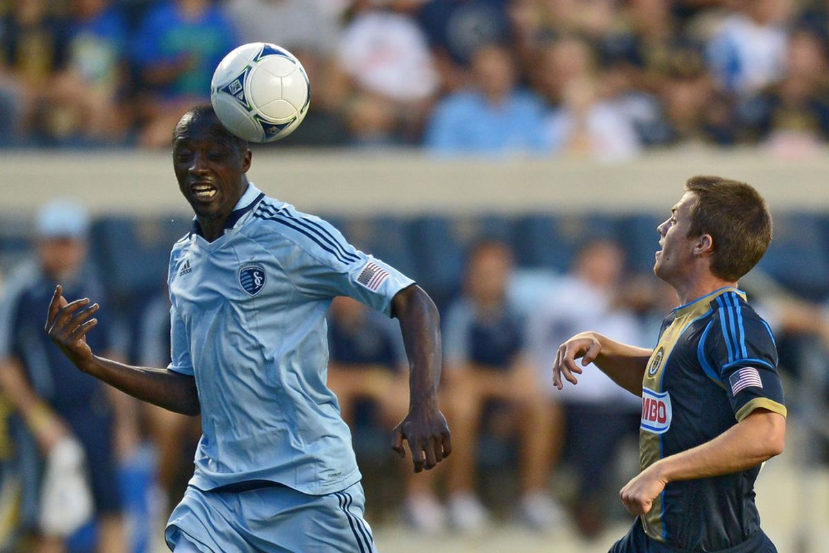 CHESTER, PA- JUNE 23: Lawrence Olum #13 of the Sporting Kansas City heads the ball past Antoine Hoppenot #29 of the Philadelphia Union at PPL Park on June 23, 2012 in Chester, Pennsylvania. The Union won 4-0. (Photo by Drew Hallowell/Getty Images)