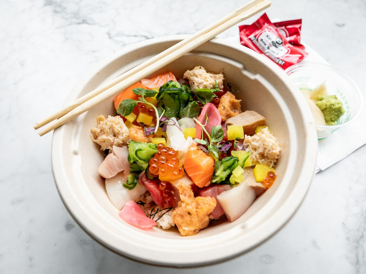Ju-Ni's takeout chirashi bowl featuring many colorful pieces of raw fish scattered over rice