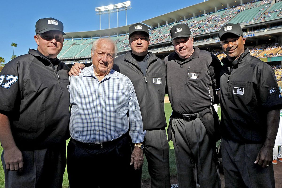 May 28, 2012; Los Angeles, CA, USA;  Umpire crew poses with Los Angeles Dodgers Tommy Larorda before the game against the Milwaukee Brewers.Mandatory Credit: Jayne Kamin-Oncea-US PRESSWIRE