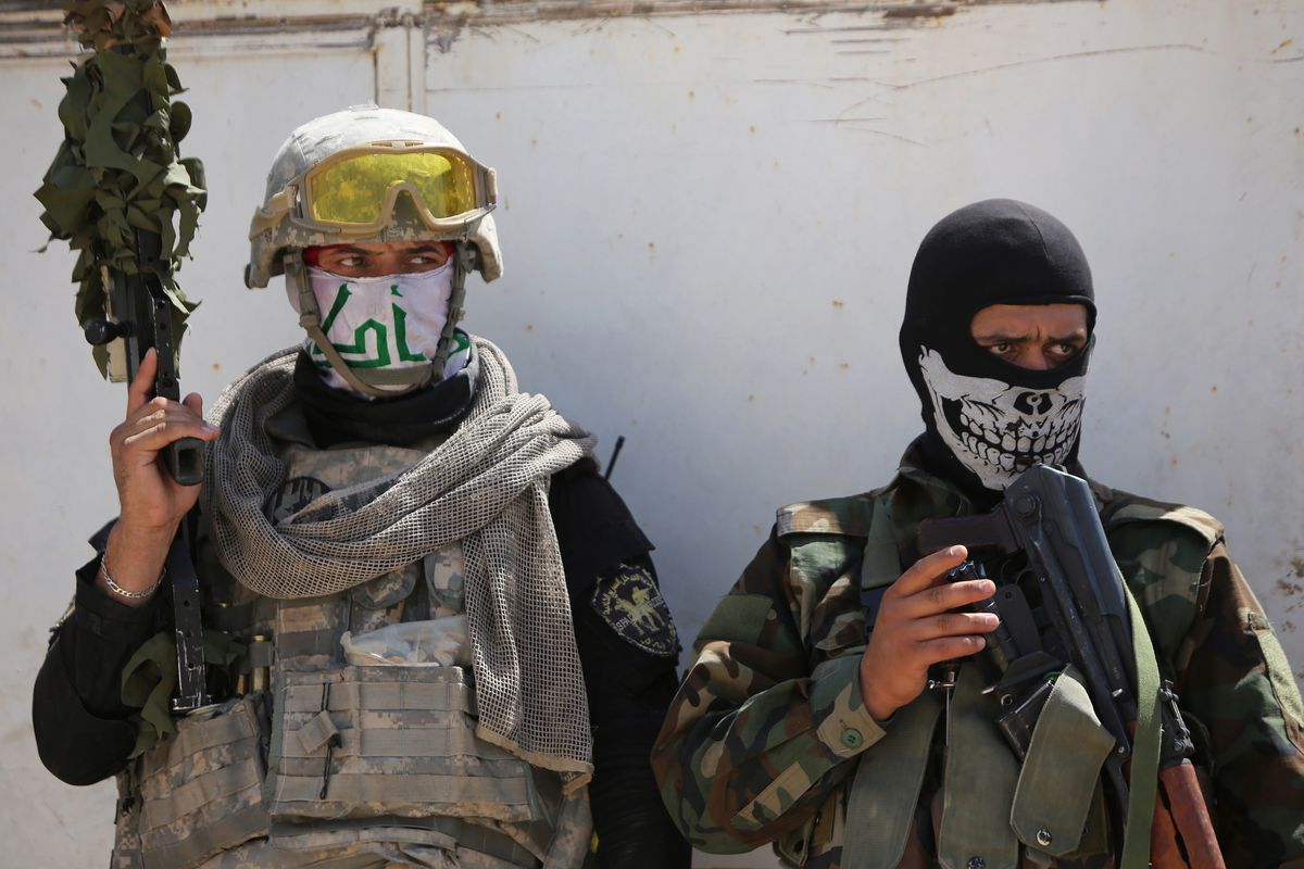 Iraqi Shia militia fighters after combat with ISIS near Amerli, Iraq.