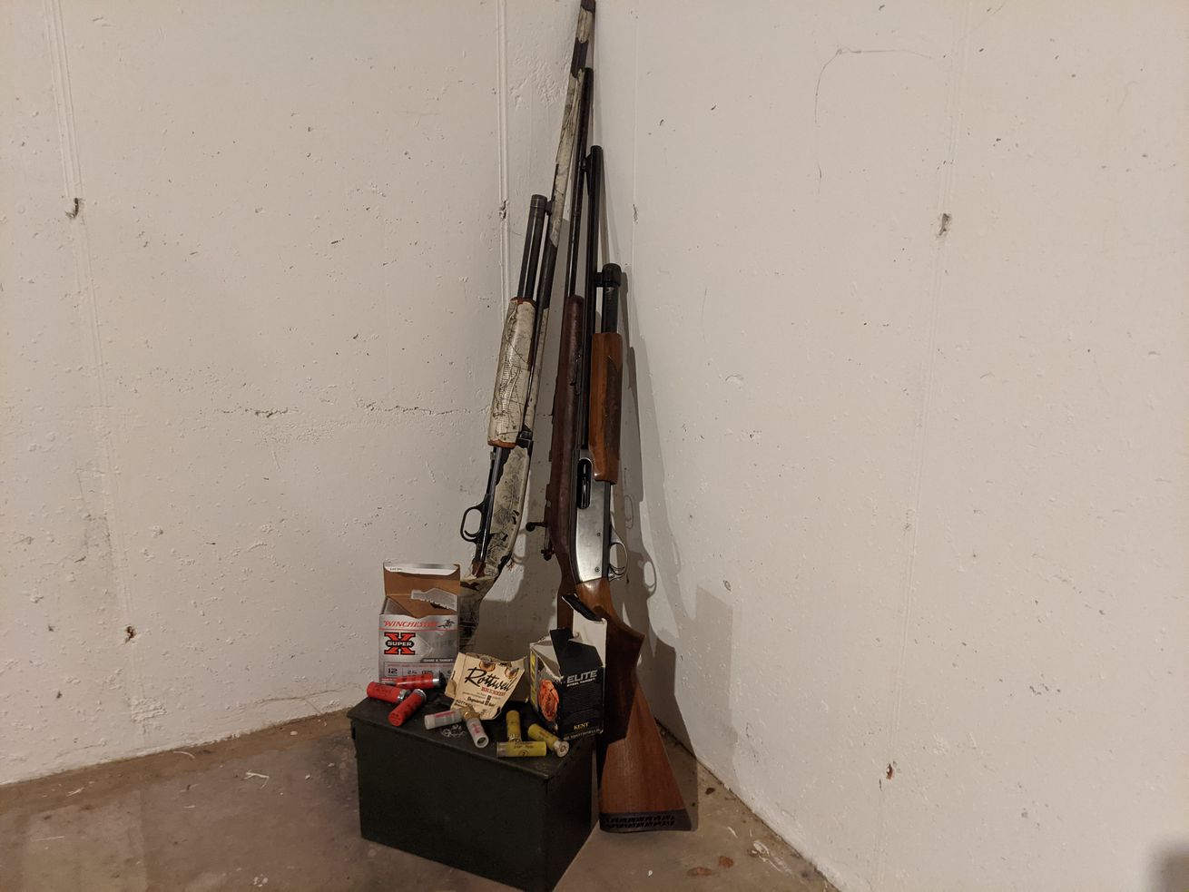 Illinois residents need a Firearm Owner's Identification Card (FOID card) to legally possess firearms or ammunition, such as this still life of a 12-gauge shotgun, a .22 rifle and a 20-gauge shotgun with shotgun shells and slugs atop an ammo box. Credit: Dale Bowman