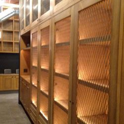 '70s-style cabinets will hold bottles of wine and spirits, while slots ahead will keep the vinyl collection