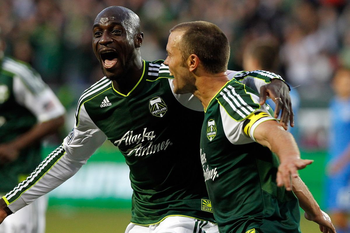 PORTLAND, OR - JULY 03:  Jack Jewsbury #13 of the Portland Timbers celebrates his 2nd half goal with Mamadou Danso #98 against the San Jose Earthquakes on July 3, 2012 at Jeld-Wen Field in Portland, Oregon.  (Photo by Jonathan Ferrey/Getty Images)