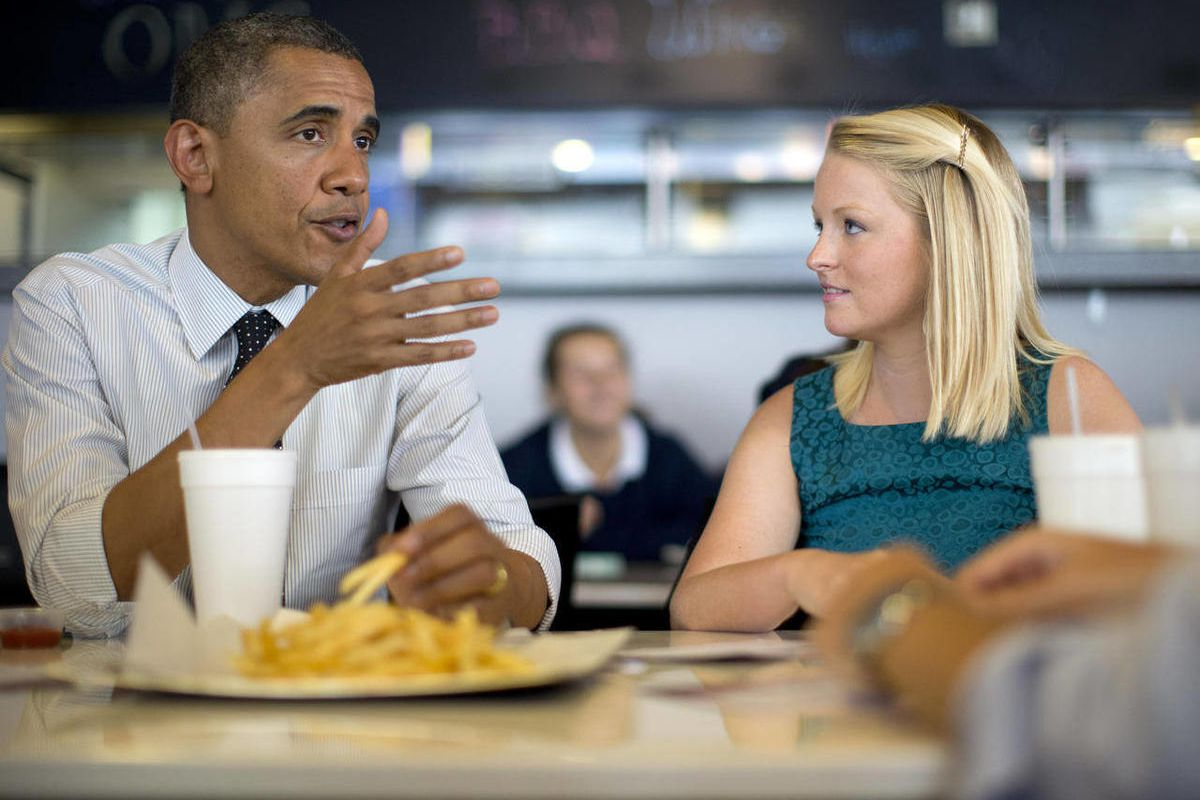President Barack Obama visits Emily Young, first time voter, and student and University of Miami  at OMG Burger, Thursday, Sept. 20, 2012, in Miami, Fla.