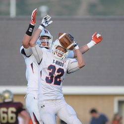 Braydon Galland celebrates a touchdown with Dax Raymond. Timpview reigned supreme over Lone Peak 36-33.