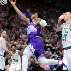 Utah Jazz guard Donovan Mitchell (45) goes around Boston Celtics center Daniel Theis (27) for two of his game-high 37 points as the Utah Jazz and the Boston Celtics play an NBA basketball game at Vivint Smart Home Arena in Salt Lake City on Wednesday, Feb. 26, 2020. Boston won 114-103.