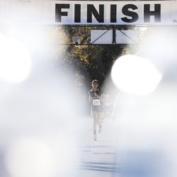Wendover High School runner Stephanie Magallanes crosses the finish line during the 1A State Cross-Country Championships at Sugar House Park and Highland High School in Salt Lake City on Wednesday, Oct. 23, 2019.