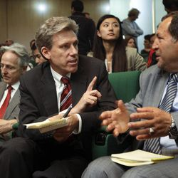 In this Monday, April 11, 2011 file photo, U.S. envoy Chris Stevens, center, accompanied by British envoy Christopher Prentice, left, speaks to Council member for Misrata Dr. Suleiman Fortia, right, at the Tibesty Hotel where an African Union delegation was meeting with opposition leaders in Benghazi, Libya.